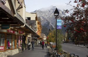 The main street in Banff with the mountain in the background.