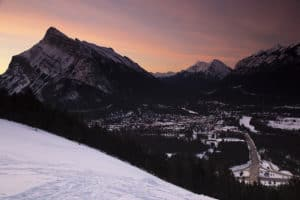 A pink sky from a sunrise over Banff, Alberta