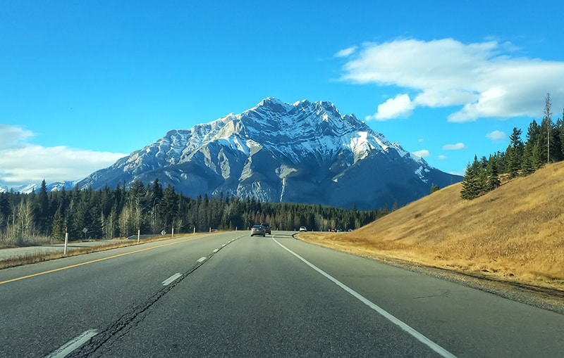 Driving from Calgary to Banff by car.