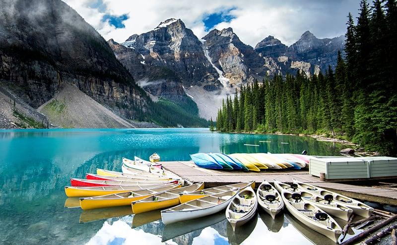 Canoes line Moraine Lake, Alberta