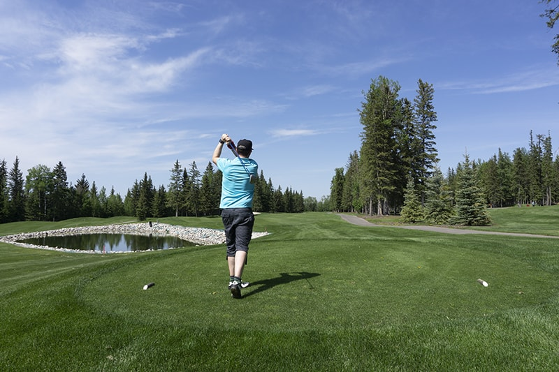 Teeing off on a sunny day at the Sundre golf course