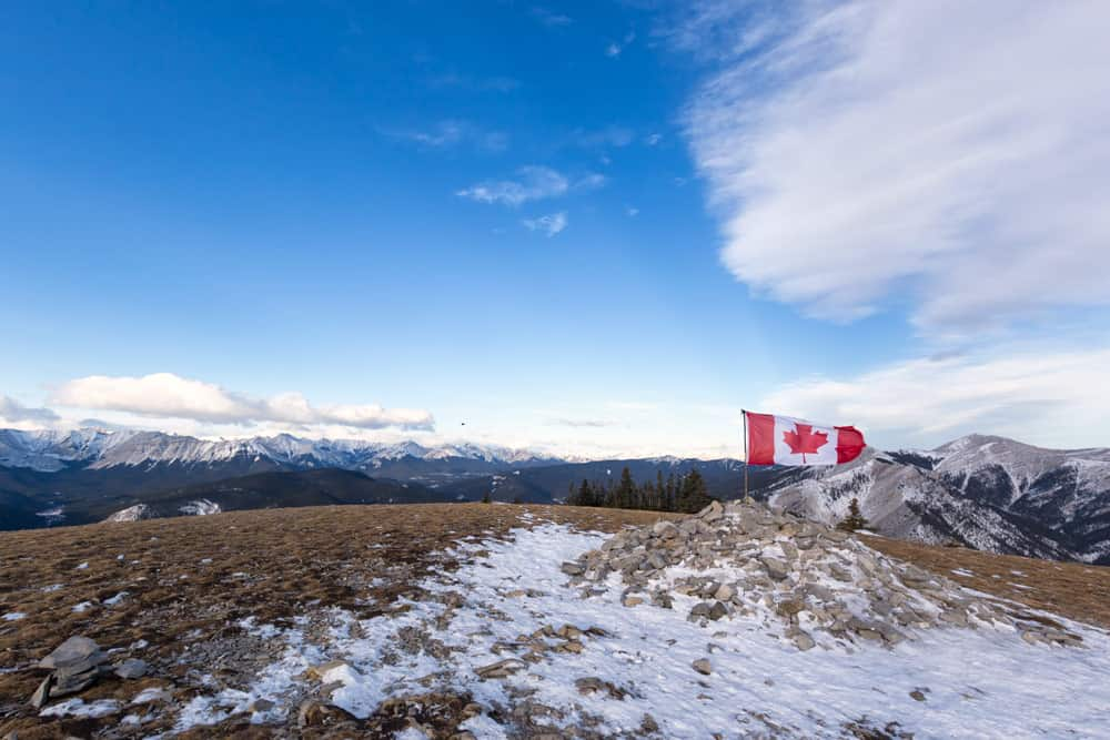 On top of the peak of Prairie Mountain, a popular hike in Alberta.