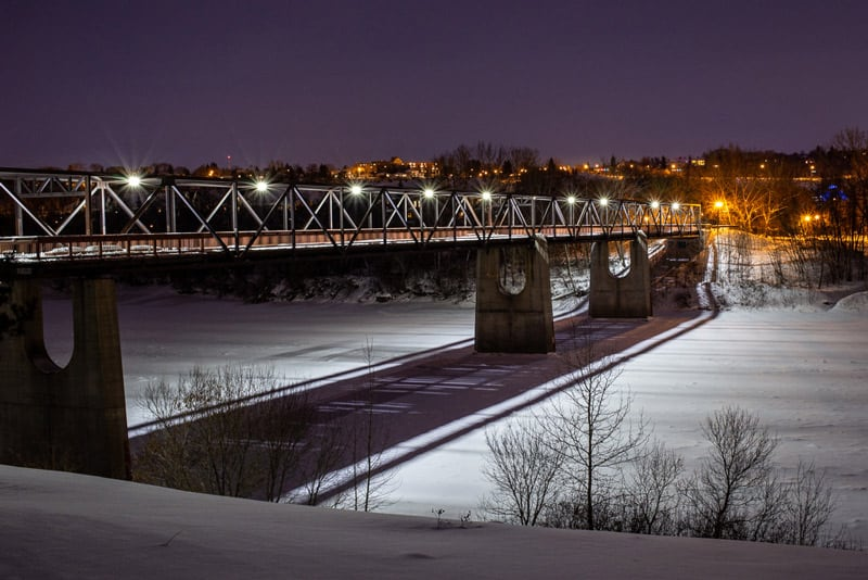 Cloverdale footbridge located in Edmonton at night in winter