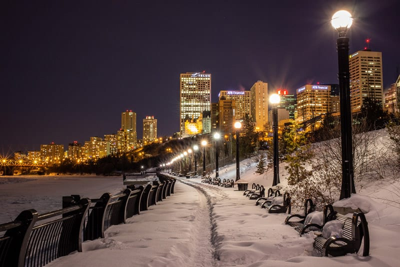 Pathway along river in downtown Edmonton at night in the winter