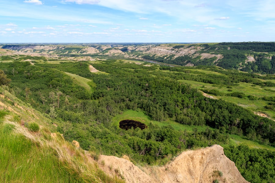 The view of Dry Island Buffalo Jumpfrom above. From here you can see the coulee, winding river, ponds and trees.