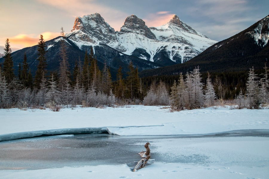 The Three Sisters mountain range in  winter at sunrise.