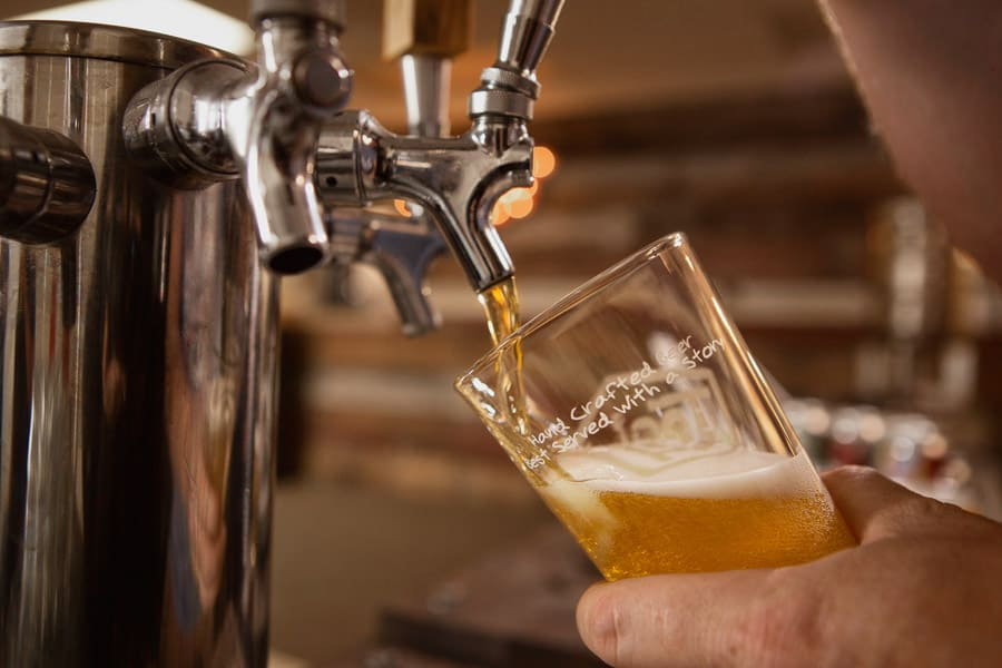 A craft beer is poured from the tap at Tool Shed Brewing in Calgary, Alberta