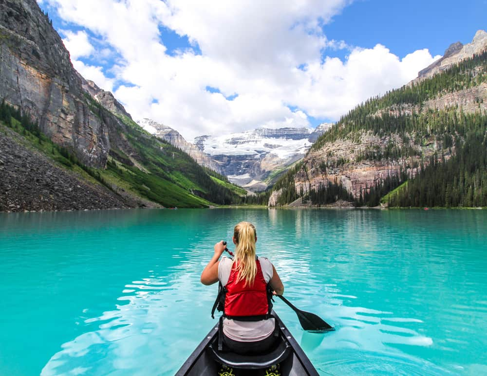 A woman paddling a canoe on Lake Louise
