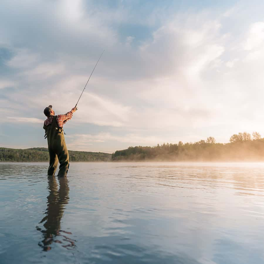 A fisherman casts a line in Alberta