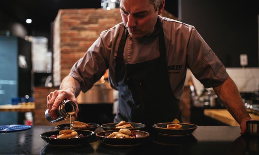 A chef prepares dishes in Edmonton, Alberta
