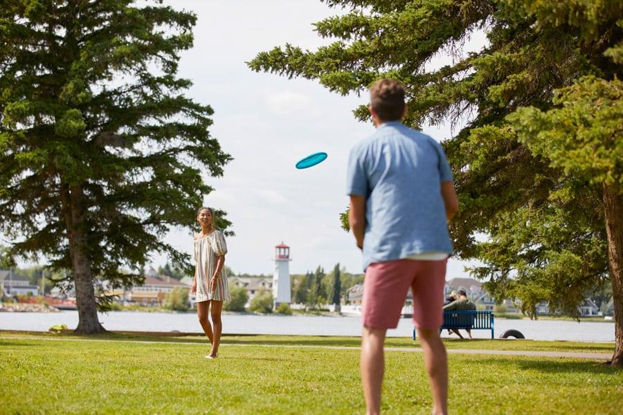 People playing frisbee at Sylvan Lake