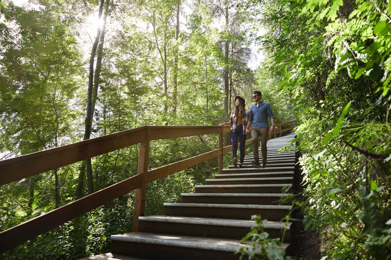 A couple walk on a trail in Red Deer