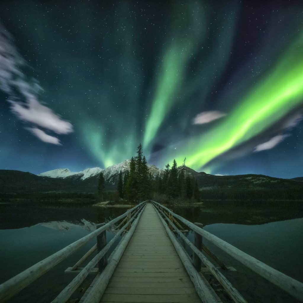 Northern Lights dance over Pyramid Lake Island in Jasper National Park